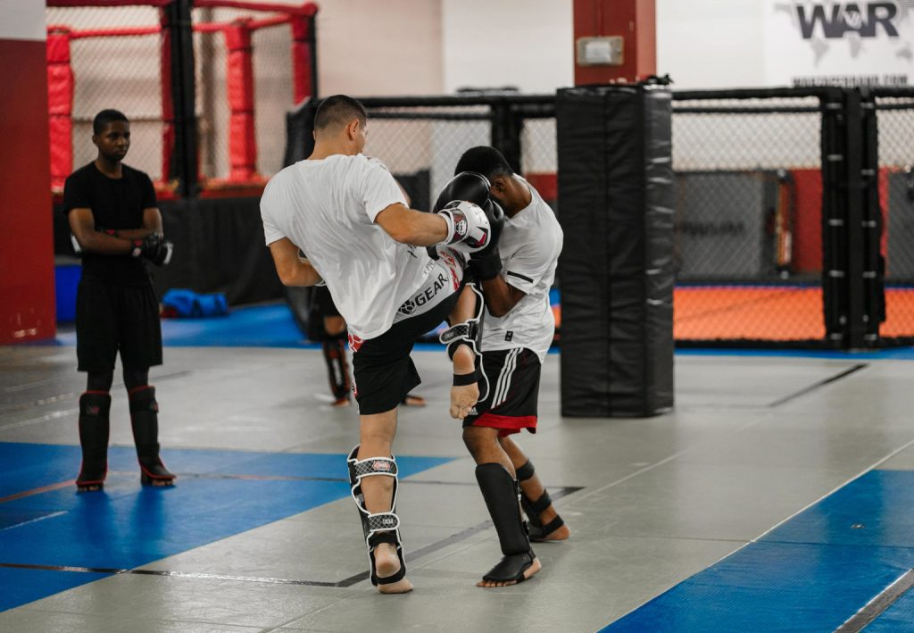 A Muay Thai Instructor Teaching How to Knee