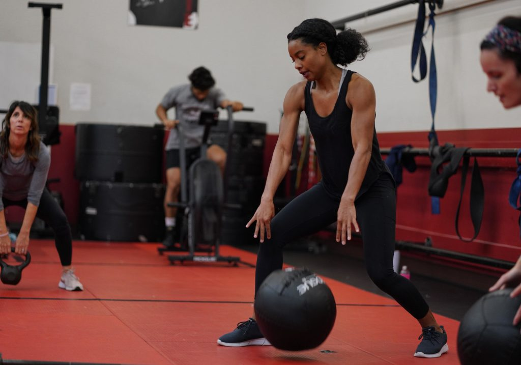 A Woman Using an Exercise Ball in a Class